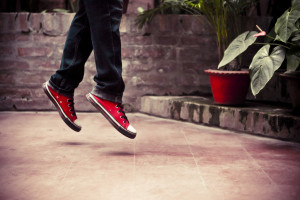 Her Flying Red Shoes